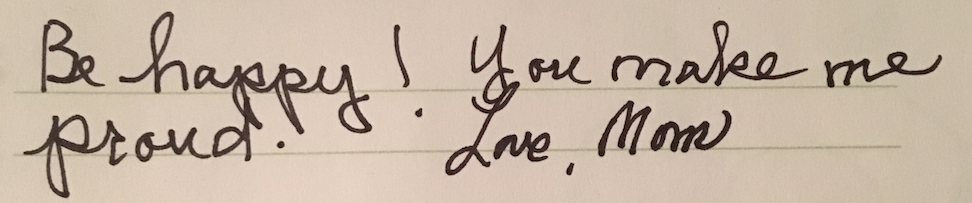 """handwritten note that says: """"be happy! you make me proud. love, mom."""""""
