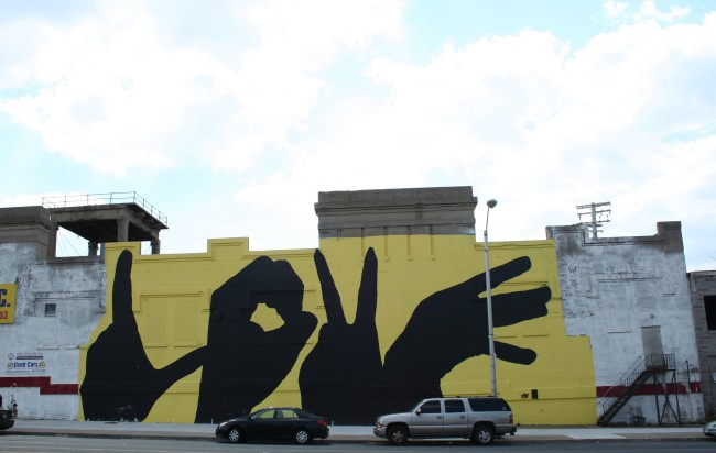 """mural of hands spelling out the word """"love"""""""