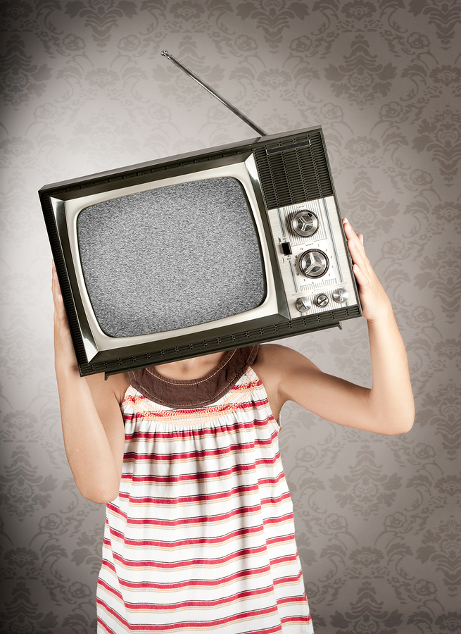 holding tv in front of head