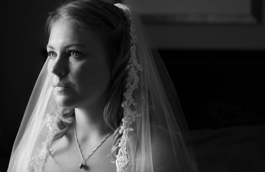 my sister on her wedding day, wearing an acorn necklace as a symbol of my mother