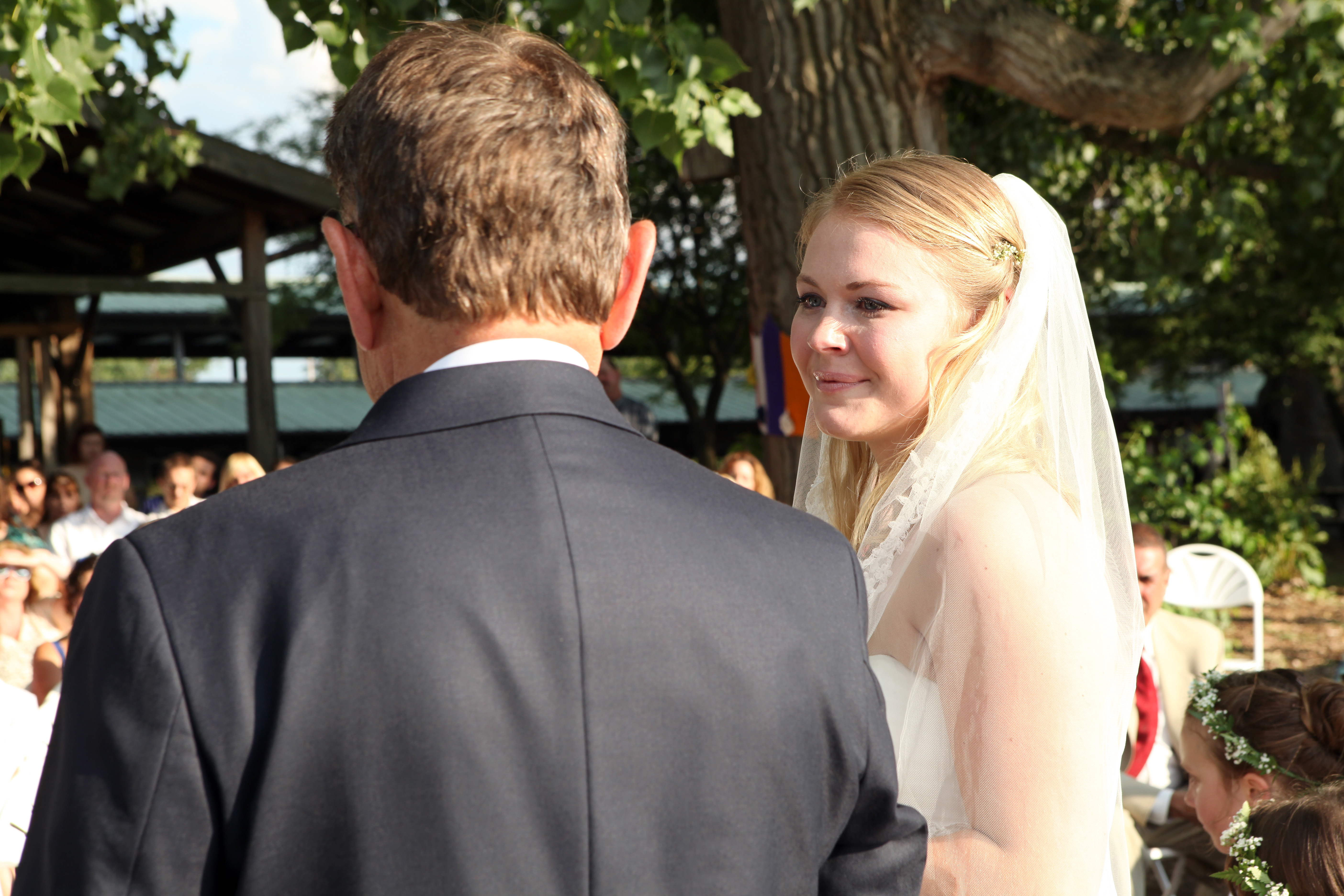 my sister on her wedding day, with my father as the officiant
