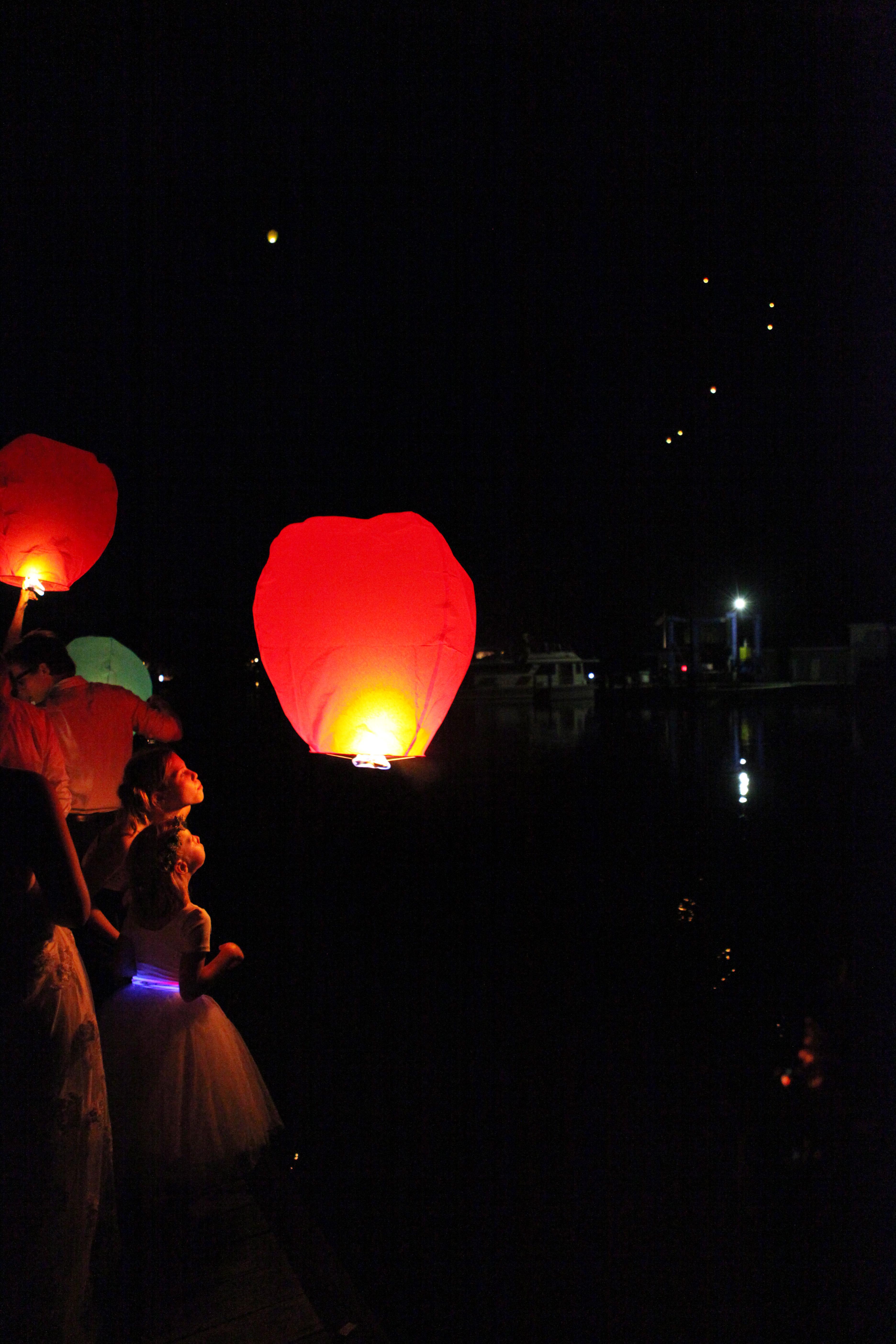 releasing lanterns at a wedding